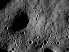 This image shows cratered regions near the moon's Mare Nubium region