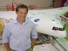 NASA aeronautics scholarship recipient and summer intern Eric Blood, next to the X-48B demonstrator