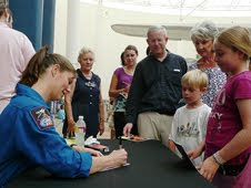 NASA Astronaut Tracy Caldwell signs autographs at the San Diego Air & Space Museum