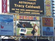 NASA Astronaut Tracy Caldwell is welcomed on the Jumbotron by the San Diego Padres during the 2009 Hometown Heroes Campaign