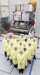 The GOES-P instrument team is pictured here in the Boeing facility with the GOES-P satellite after completion of the instrument testing