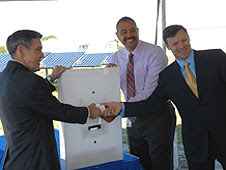 Kennedy Space Center Director Bob Cabana, left, Roderick Roche of SunPower Corp., and Florida power & LIght's Eric Silagy symbolically turn on the one megawatt solar energy center at KSC