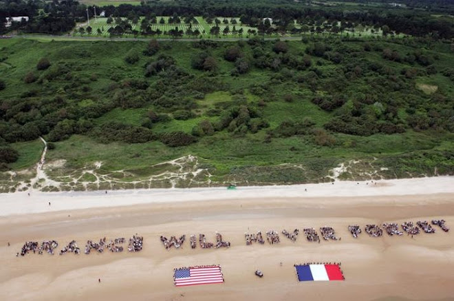 "2500 people gather on Omaha Beach in Normandy to Form a ""Human Chain"" of gratitude"