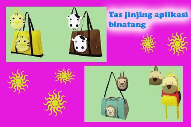 Tas jinjing dengan aplikasi boneka.
