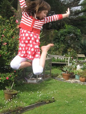 Zoe leaping in her new kit