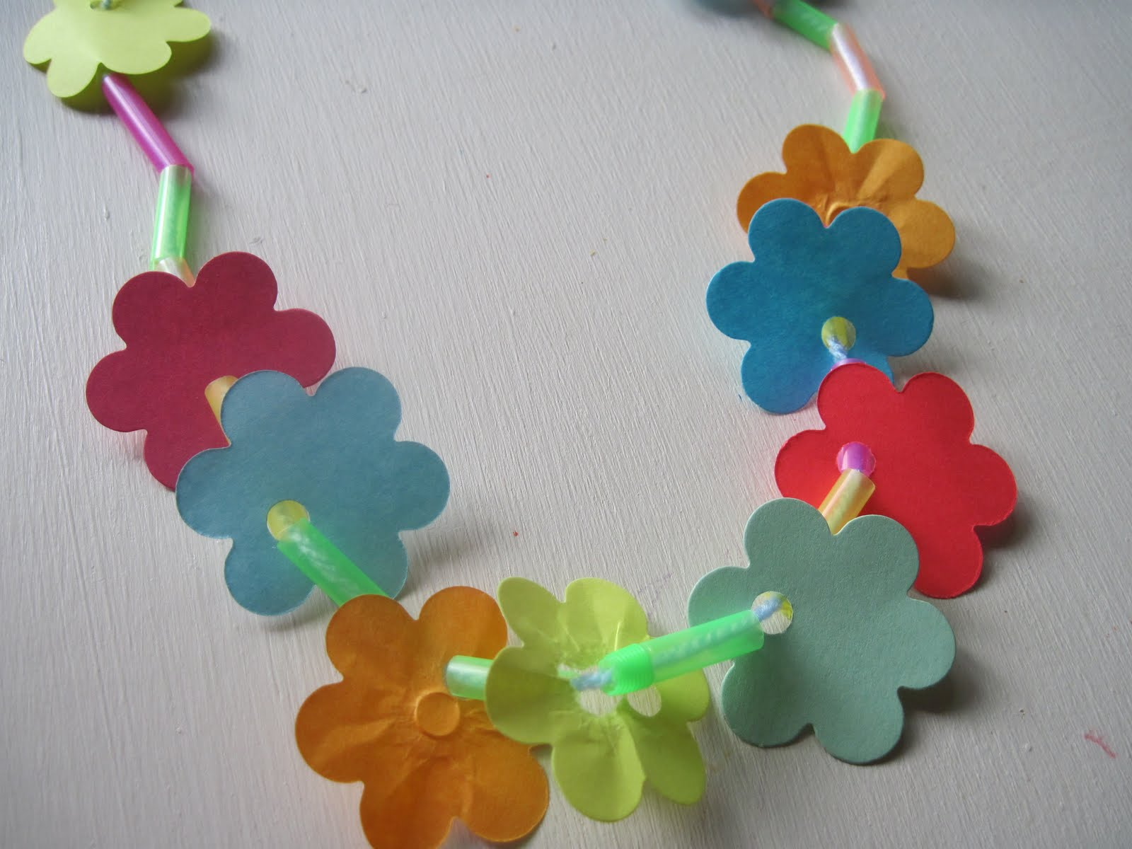 Kids matter hawaii craft paper flowers or artificial flowers with a hole punched in them straws that are cut into 2 3 pieces izmirmasajfo