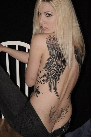 tribal wings tattoos. cross wings tattoos chinese