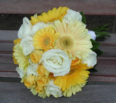 and butter yellow gerbera daisies with pure white roses wedding bouquet