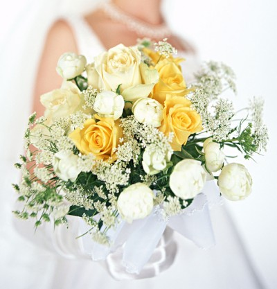 Canary yellow roses mixed with white roses bouquet
