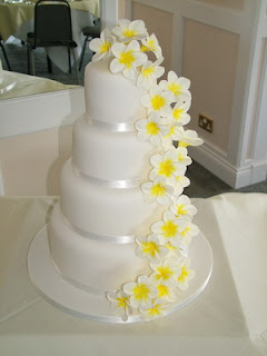 Photos Of Wedding Cakes Three Tier With Frangipanis