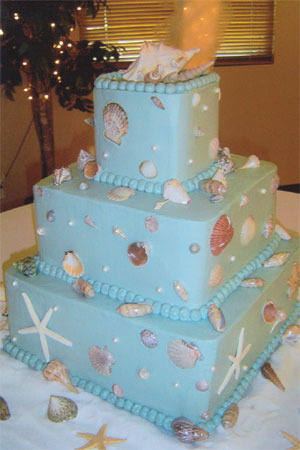 Stunning round four tier light blue wedding cake shaped to look as though