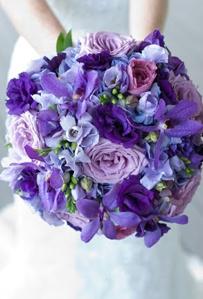Gorgeous purple themed bridal bouquet with long stems