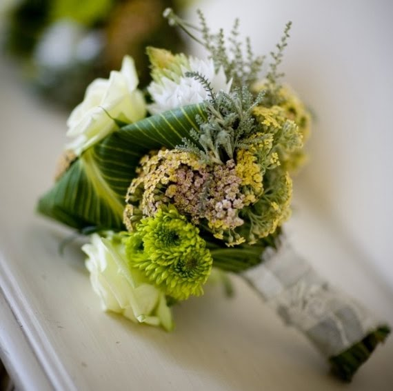 in the same green and white unusual wedding flower arrangement