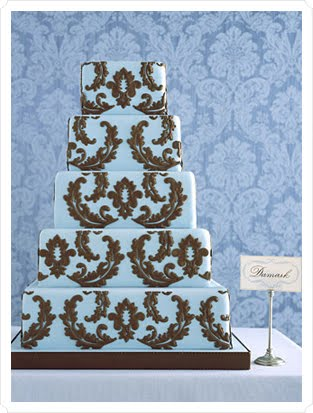 Gorgeous 6 tier round wedding cake in pale baby blue and white with delicate