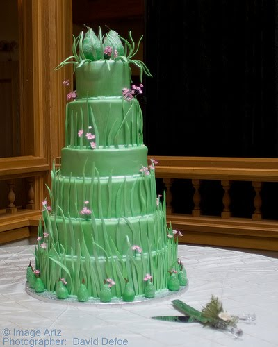 Amazing six tier wedding cake in a lovely green with tiny pink flowers
