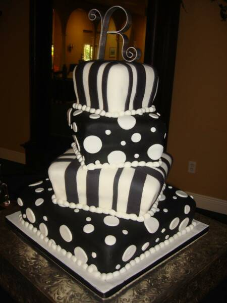 Funky black and white cake with circles and diamonds.
