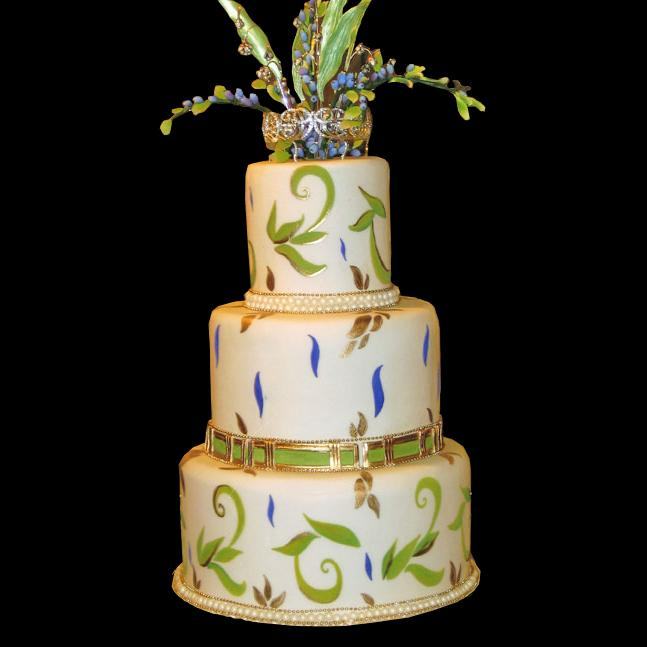 Gold purple and green hand painted wedding cake a row of pearls lines each