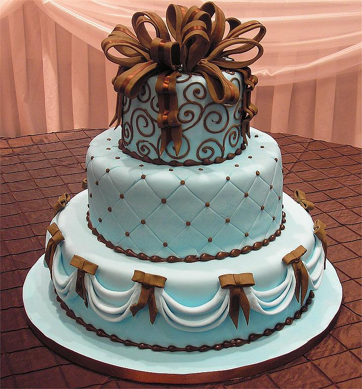 Three tier blue wedding cake with brown bows