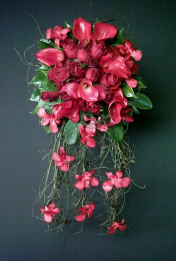Red roses calla lilies and re orchids cascading wedding bouquet