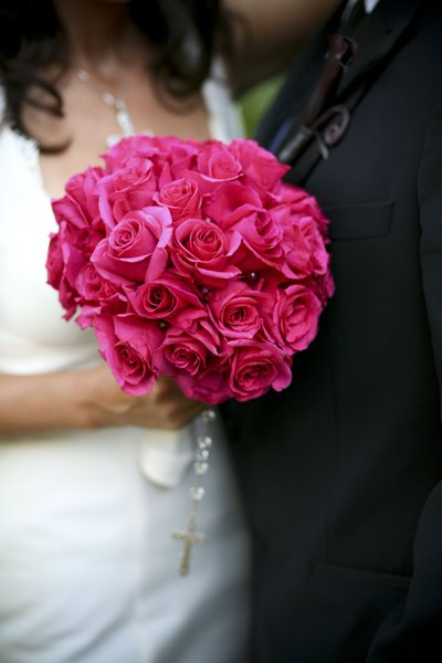 Bright Pink Rose bridal bouquet The pink roses stems are wrapped in white