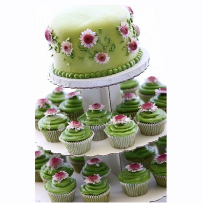 pink and white wedding cupcakes. Wedding cupcakes and a top cake all dressed up in white, lime green