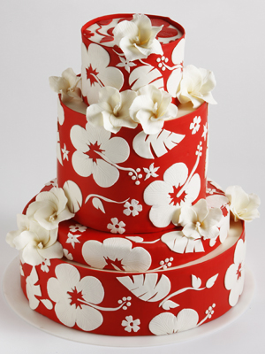 Bright red wedding cake set over three tiers with red and burgundy roses