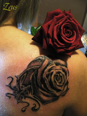 Get a Rose Tattoo is great. Besides the roses are the best tattoo designs,