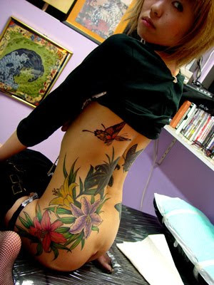 Label: Flower Tattoo, Lower Back Tattoo, tattoo, Tattoo Designs,