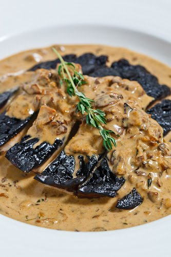 Grilled Portobello Mushroom in a Porcini Cream Sauce