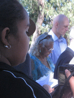 Peter Garrett and an aboriginal girl at the Rock