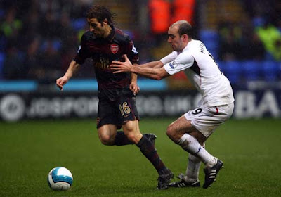 Gavin McCann of Bolton Wanderers and Mathieu Flamini of Arsenal