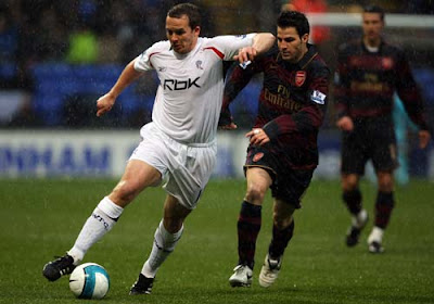 Kevin Davies of Bolton Wanderers and Cesc Fabregas of Arsenal battle for the ball