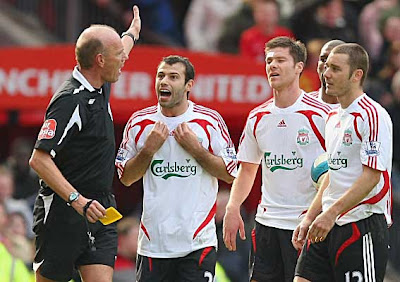 Javier Mascherano of Liverpool protests after being shown a red card by referee Steve Bennett for a second bookable offense just prior to half-time.