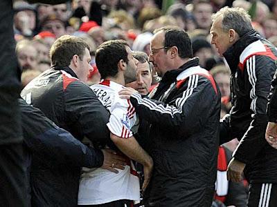 Liverpool manager Rafael Benitez tries to calm midfielder Javier Mascherano (center) after he was sent off against Manchester United.