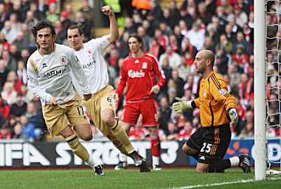 Tuncay Sanli of Middlesbrough celebrates his opening goal past Liverpool goalkeeper Jose Reina during their Premier League match at Anfield in Liverpool, England.