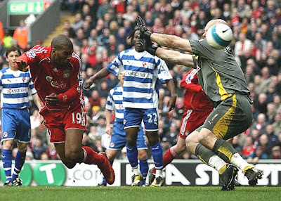 Ryan Babel of Liverpool heads past Marcus Hahnemann only for the goal to be dissalowed for offside.