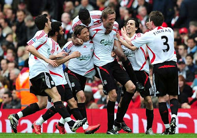 Peter Crouch of Liverpool is mobbed by teammates as he celebrates scoring the opening goal