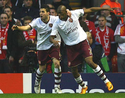 Abou Diaby (R) of Arsenal is congratulated by teammate Cesc Fabregas after scoring the opening goal at Anfield.