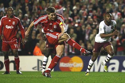 Steven Gerrard of Liverpool scores his team's third goal from the penalty spot to put the Reds up 3-2 late in the match.