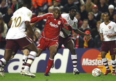 Ryan Babel of Liverpool is fouled by Kolo Toure of Arsenal to concede a penalty which led to Liverpool's third goal.