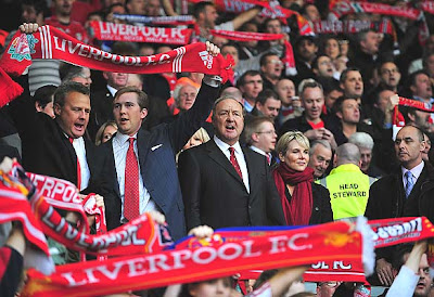 Liverpool co-owner Tom Hicks joins in the singing with his sons prior to the UEFA Champions League semifinal,