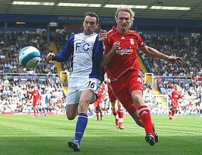 Sami Hyypia of Liverpool battles for the ball with James McFadden of Birmingham City.