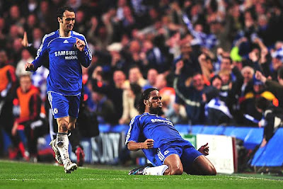 Didier Drogba of Chelsea celebrates with Ricardo Carvalho as he scores their first goal in the 33rd minute.