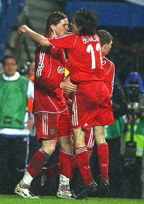 Fernando Torres of Liverpool (L) celebrates with Yossi Benayoun as he scores their first goal in the second half.