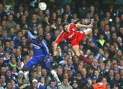 Steven Gerrard of Liverpool jumps with Claude Makelele of Chelsea.