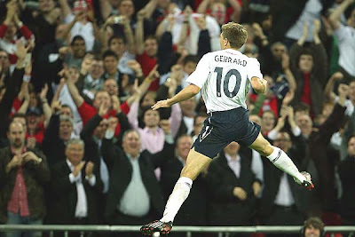Steven Gerrard of England celebrates as he scores the second goal.