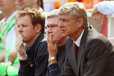 Arsene Wenger, manager of Arsenal (right), calmly watches the game between Arsenal and West Brom.