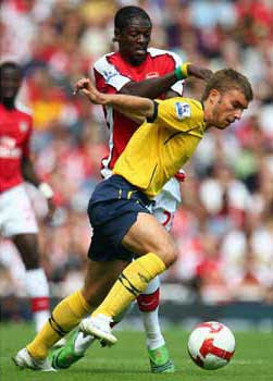 James Morrison of West Bromwich Albion battles for the ball with Emmanuel Adebayor of Arsenal