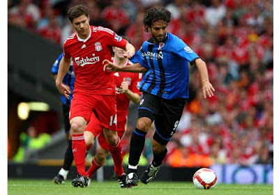 Xabi Alonso of Liverpool tackles Mido of Middlesbrough