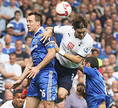 Jonathan Woodgate (right) of Tottenham Hotspur and John Terry of Chelsea challenge for the ball in the air. Spurs held on for a 1-1 draw and their first point of the season.